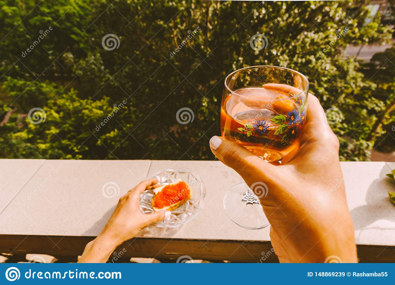 female hands holding a glass of wine
