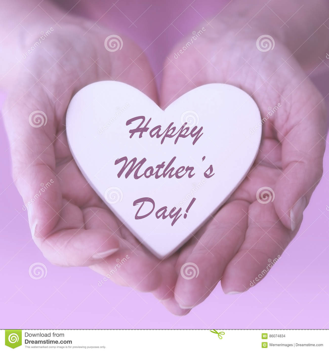 Female hands holding heart with words Happy Mothers Day