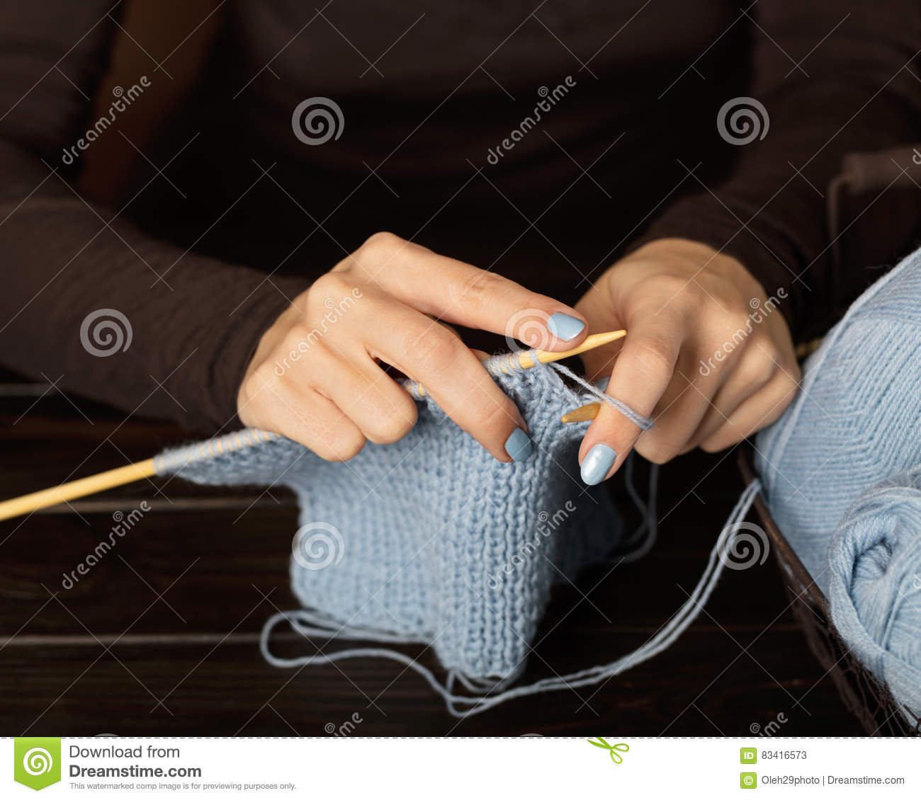 Knitting With Hands Only : Female hands knitting from light blue yarn stock photo