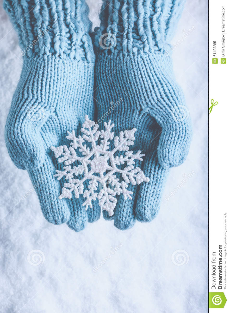 Knitting Pattern For Snowflake Mittens : Female Hands In Light Teal Knitted Mittens With Sparkling Wonderful Snowflake...