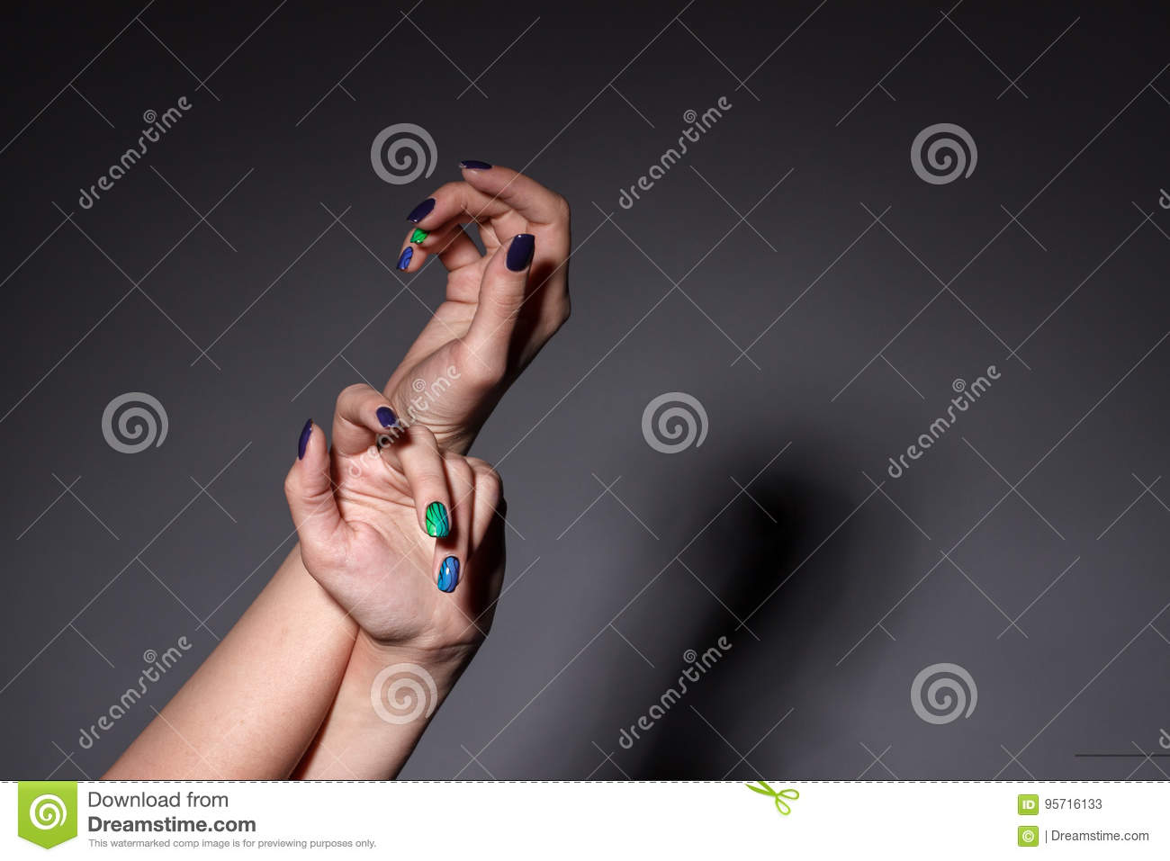 Female hands with manicure in the studio