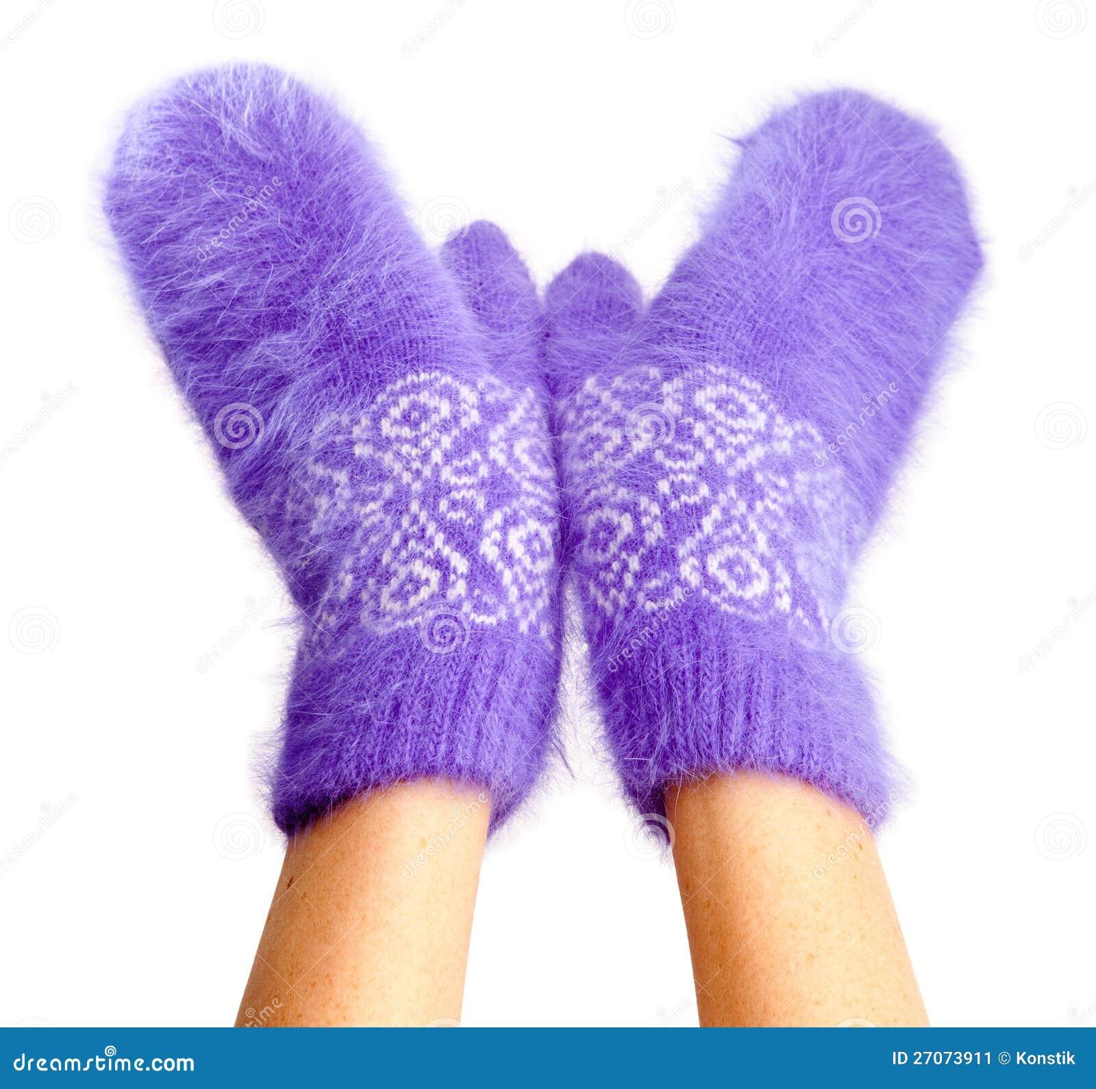 Female hands in mittens