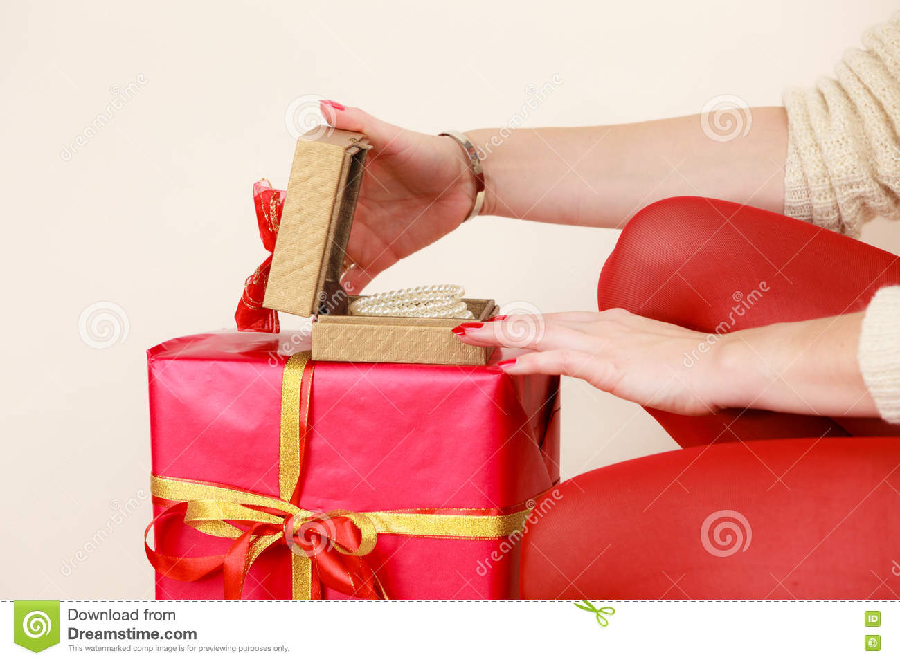 Female Hands Opening Golden Gift Box With Jewel Pearls Stock Photo ...