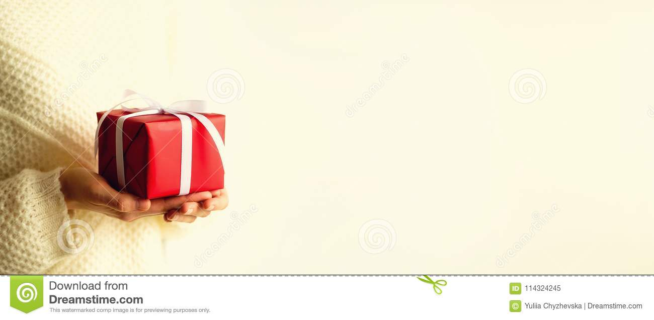 Female hands opening red gift box, copy space. Christmas, new year, birthday party, valentine`s day, mother`s and woman