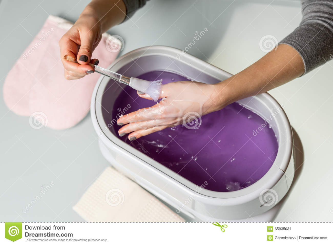 Download Female Hands In A Paraffin Wax Bowl Stock Image
