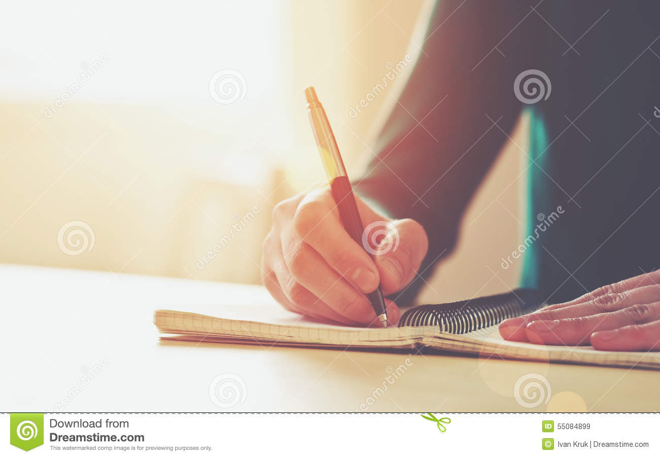 Female hands with pen writing