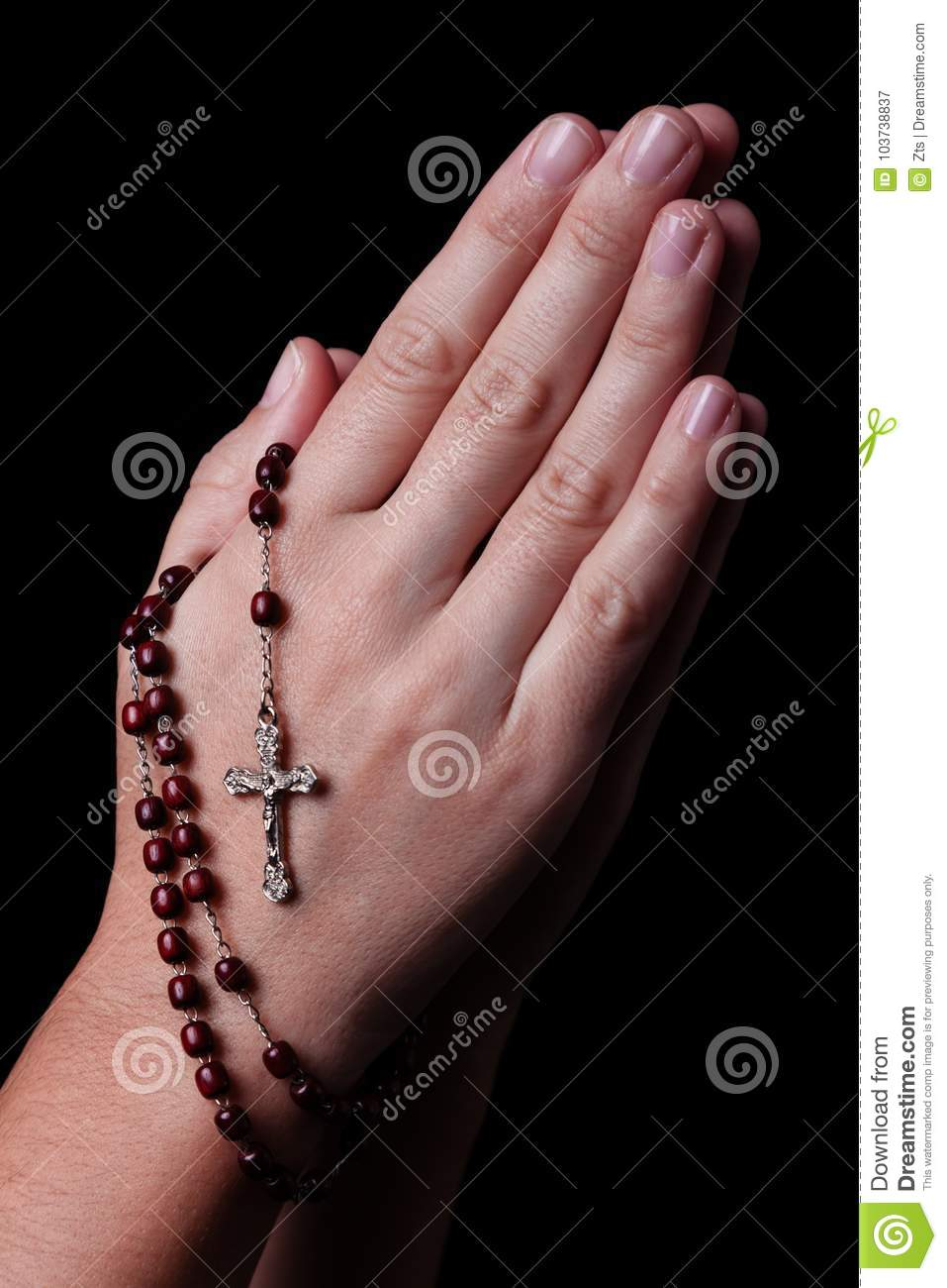 46a31d6a7 Royalty-Free Stock Photo. Female hands praying holding a rosary with Jesus  Christ in the cross or Crucifix on black