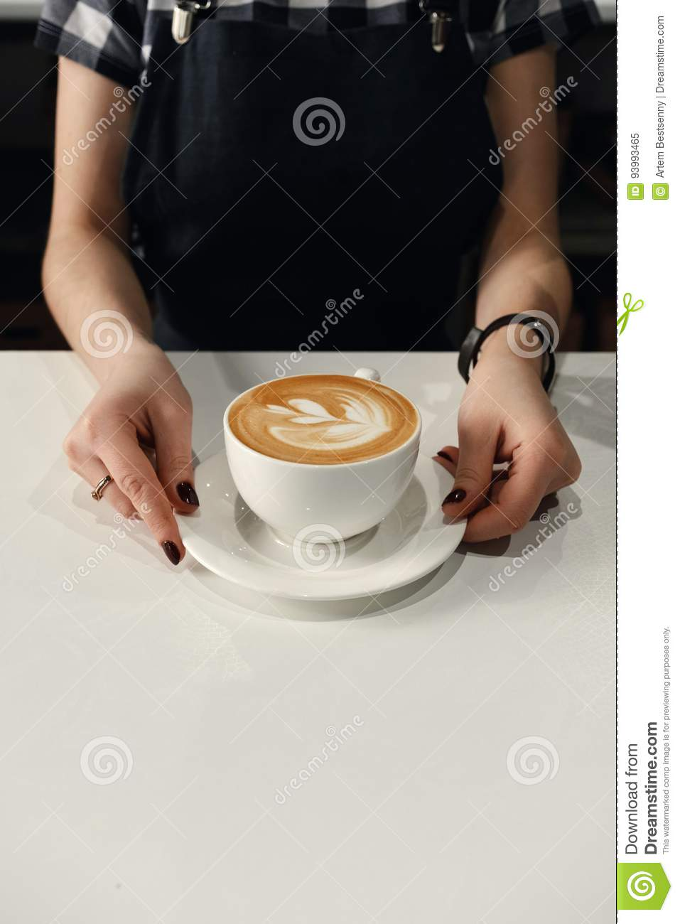 Female Hands Put On A White Table A Cappuccino Cup With ...