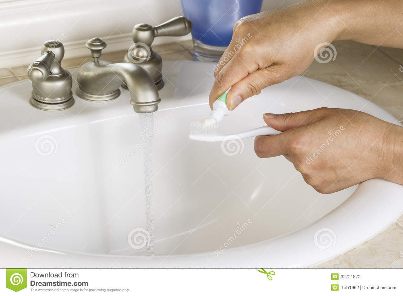 Female Hands Putting Tooth Paste On Tooth Brush Stock