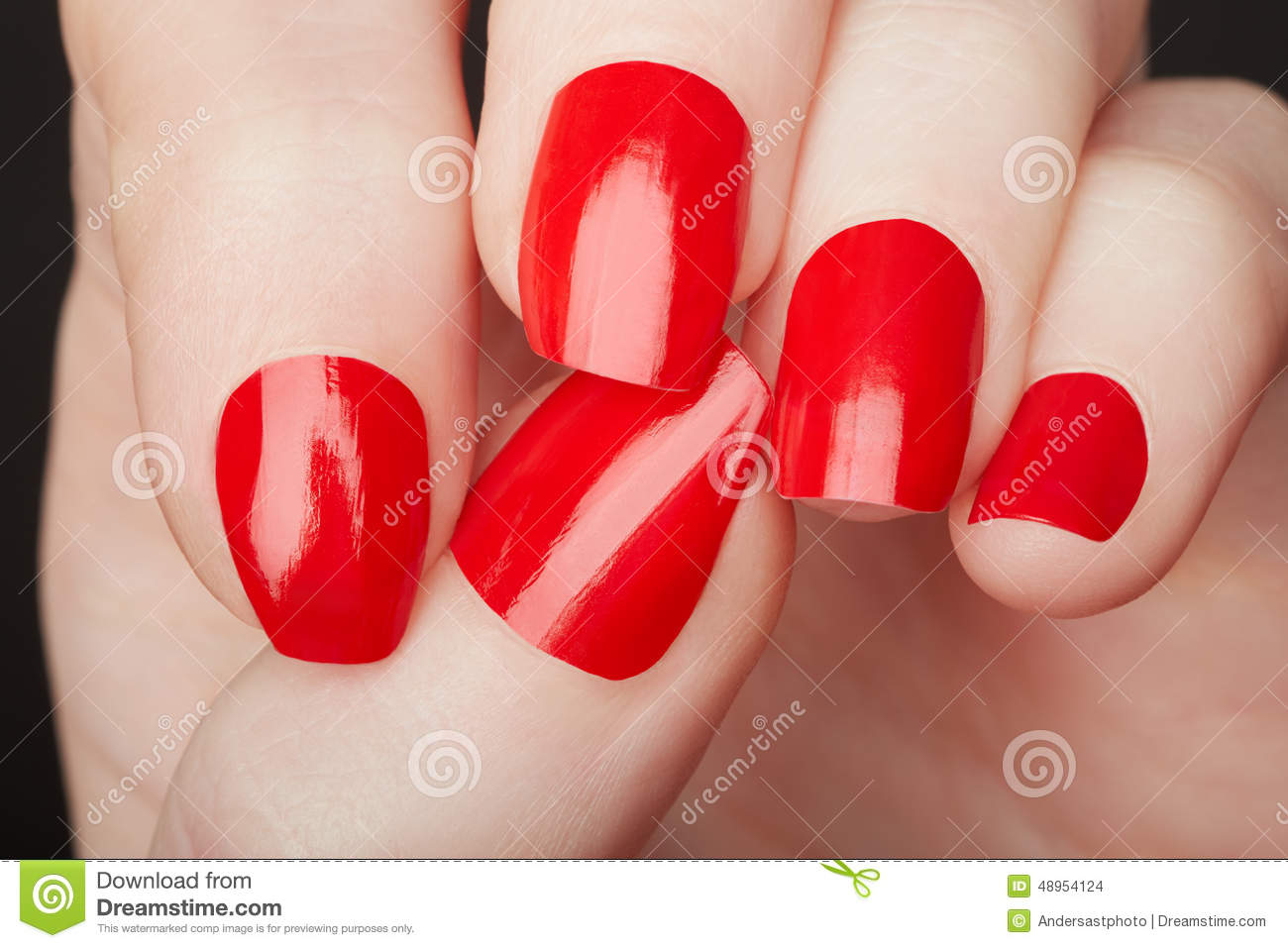 female hands with red nail polish close up stock photo