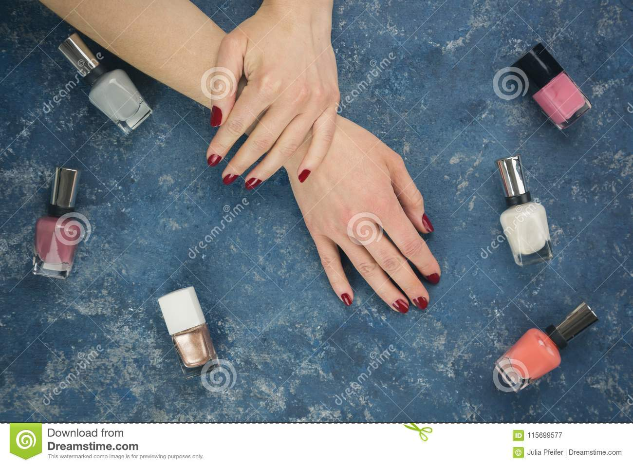 Female Hands With Nail Polish On Blue Background Stock Image Image
