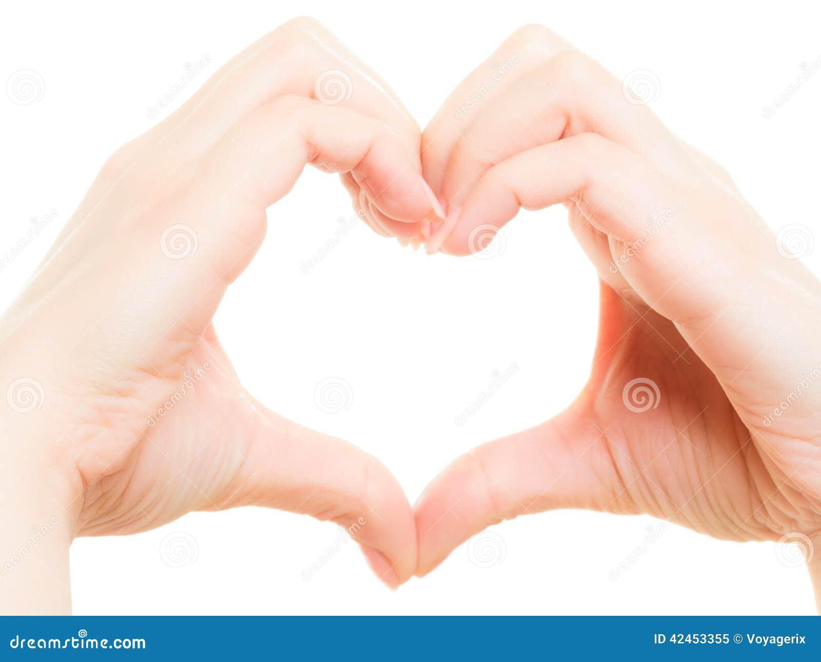 Female hands showing heart shape symbol of love