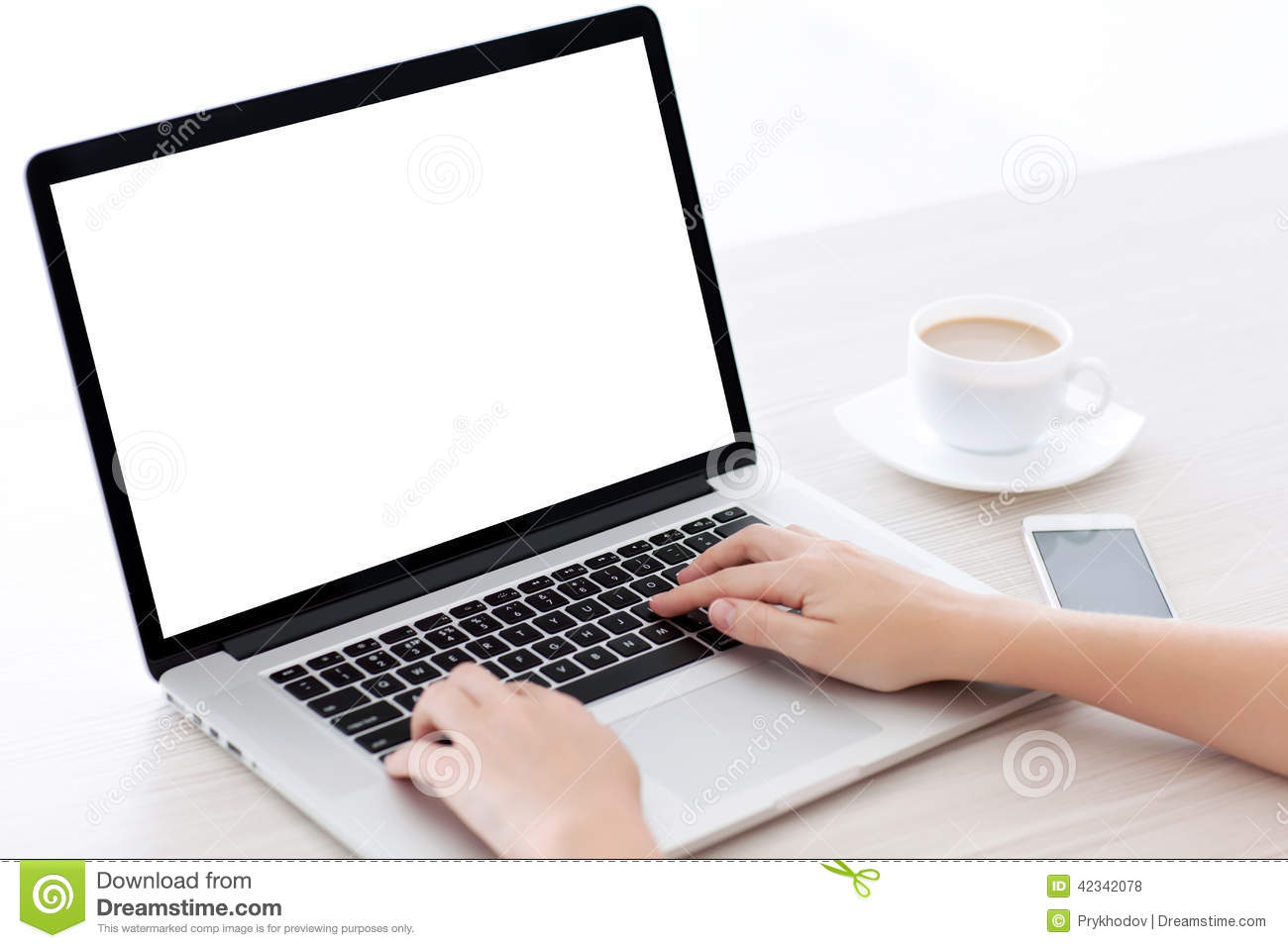 Female hands typing on a laptop keyboard with screen in