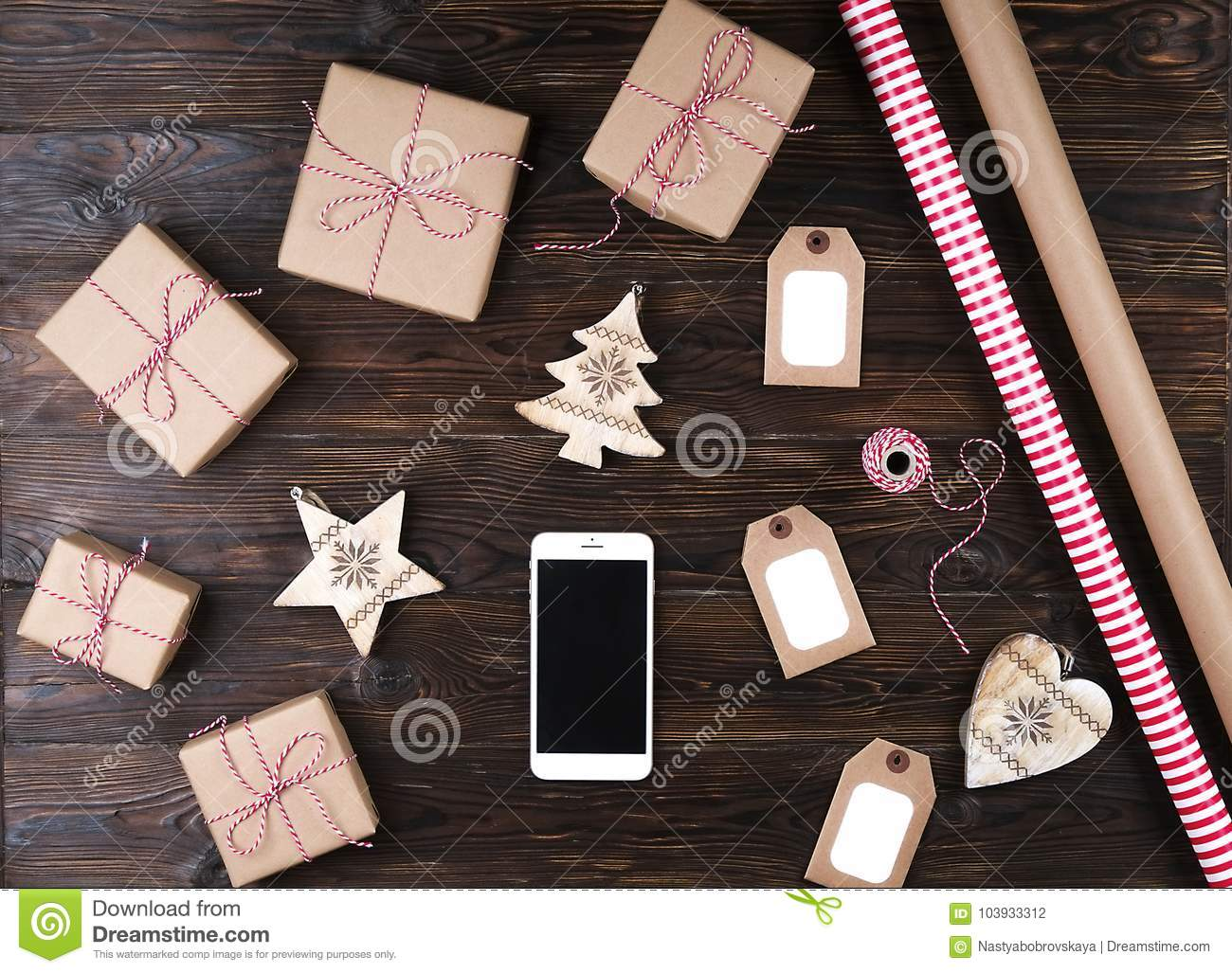 Smart Phone With Christmas Presents On Wooden Background Top View ...