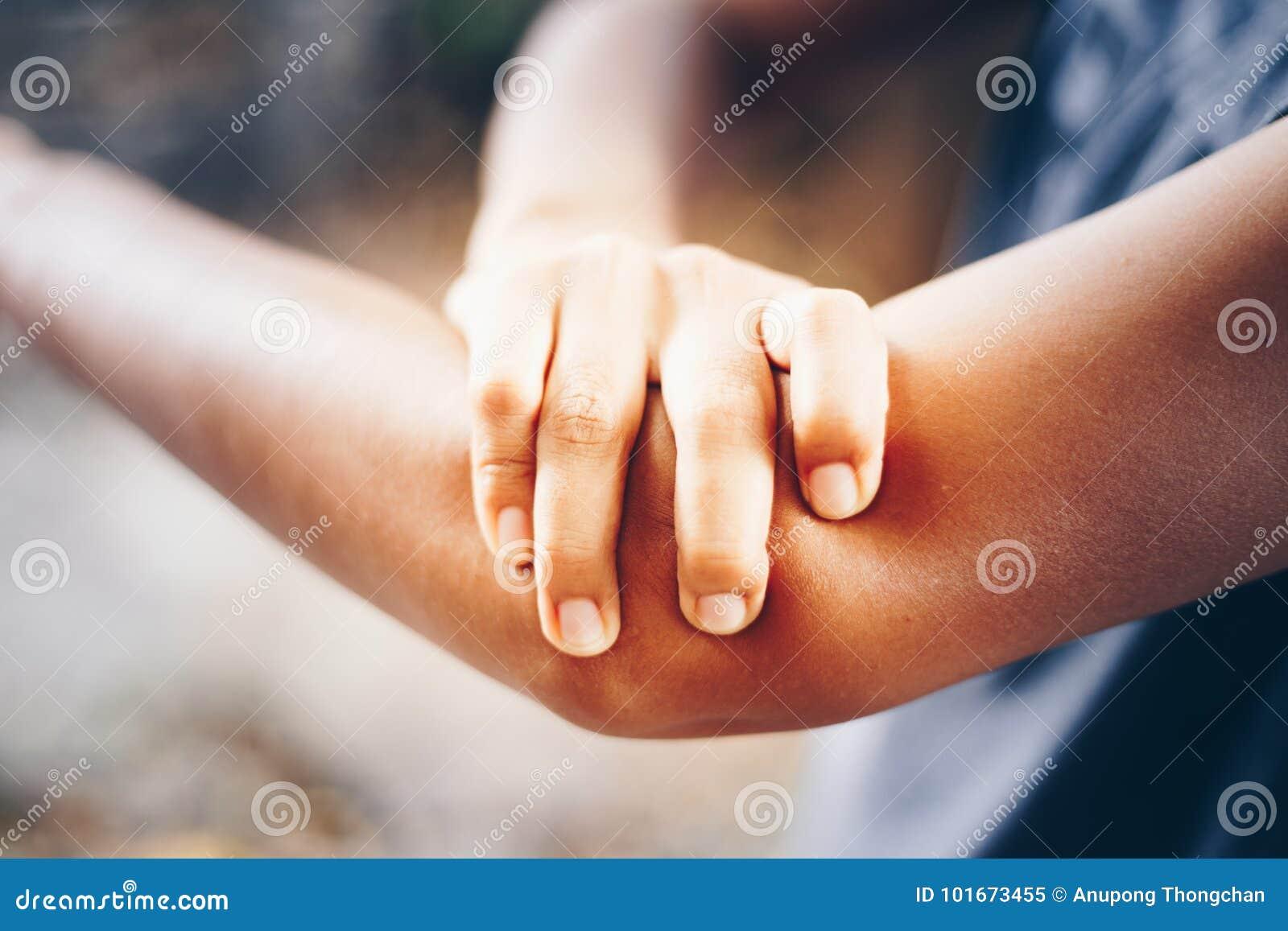 Female having pain in injured arm.