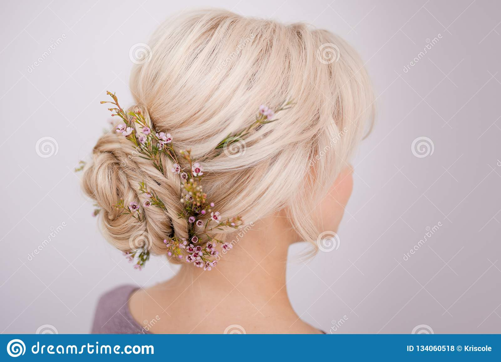 female head back view. make an elegant hairstyle with petals