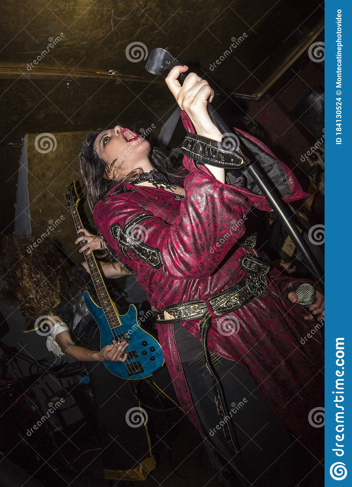 Female Heavy Metal Vocalist Dressed In Red Singing Editorial Stock Image Image Of Malaga Banging 184130524