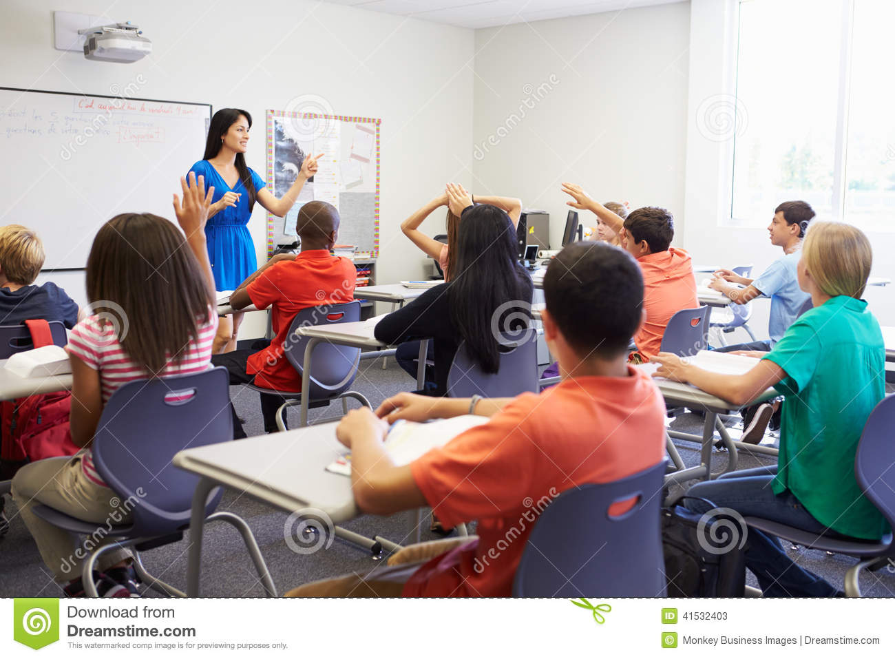 Female High School Teacher Taking Class