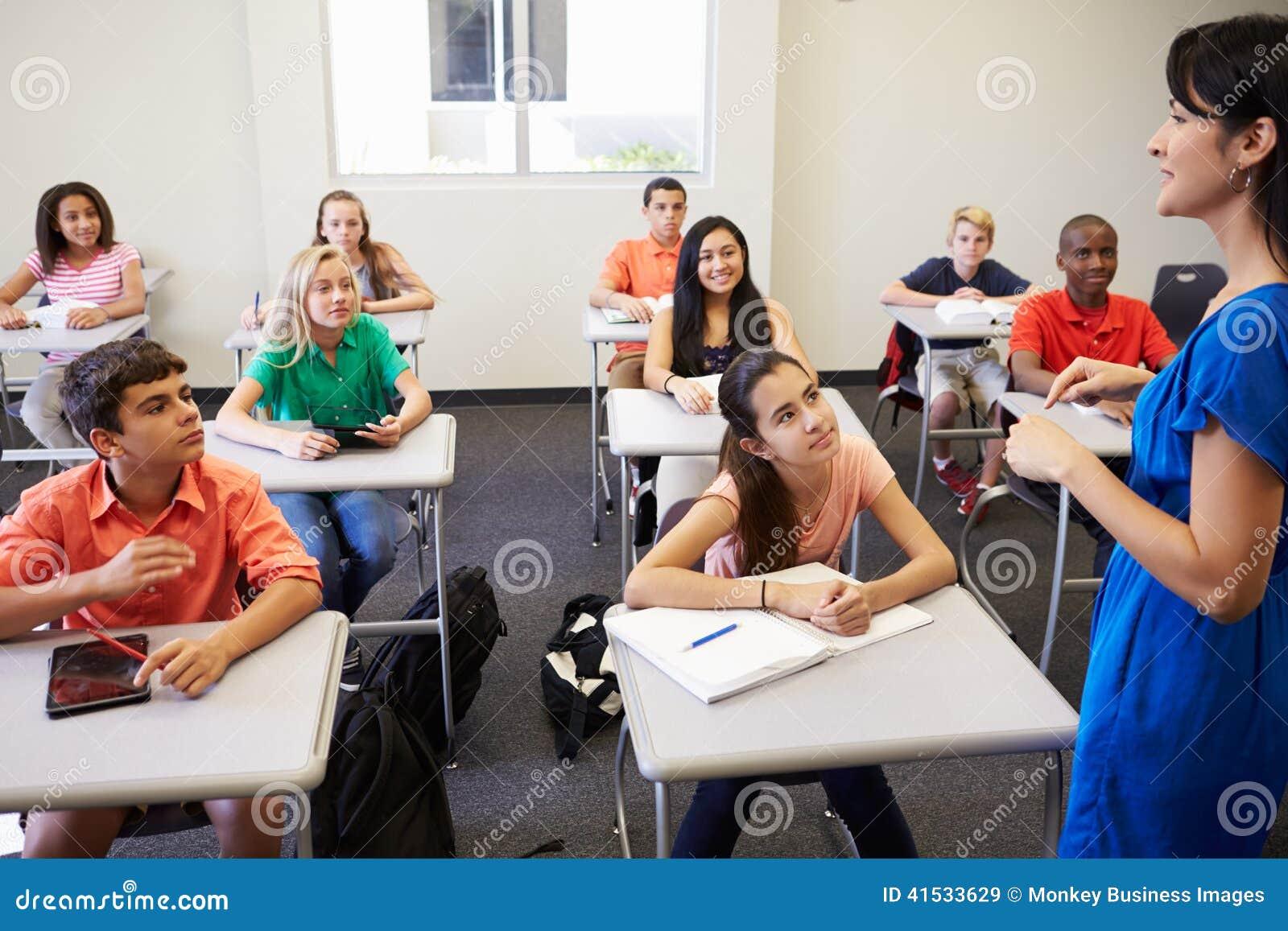 Classroom Presentation Ideas ~ Female high school teacher taking class stock photo