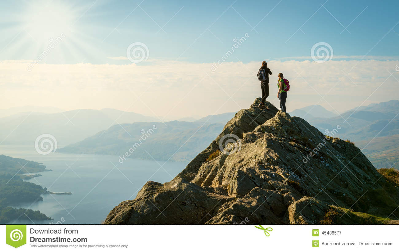 Download Female Hikers On Top Of The Mountain Enjoying Valley View Stock Image - Image of active, bright: 45488577