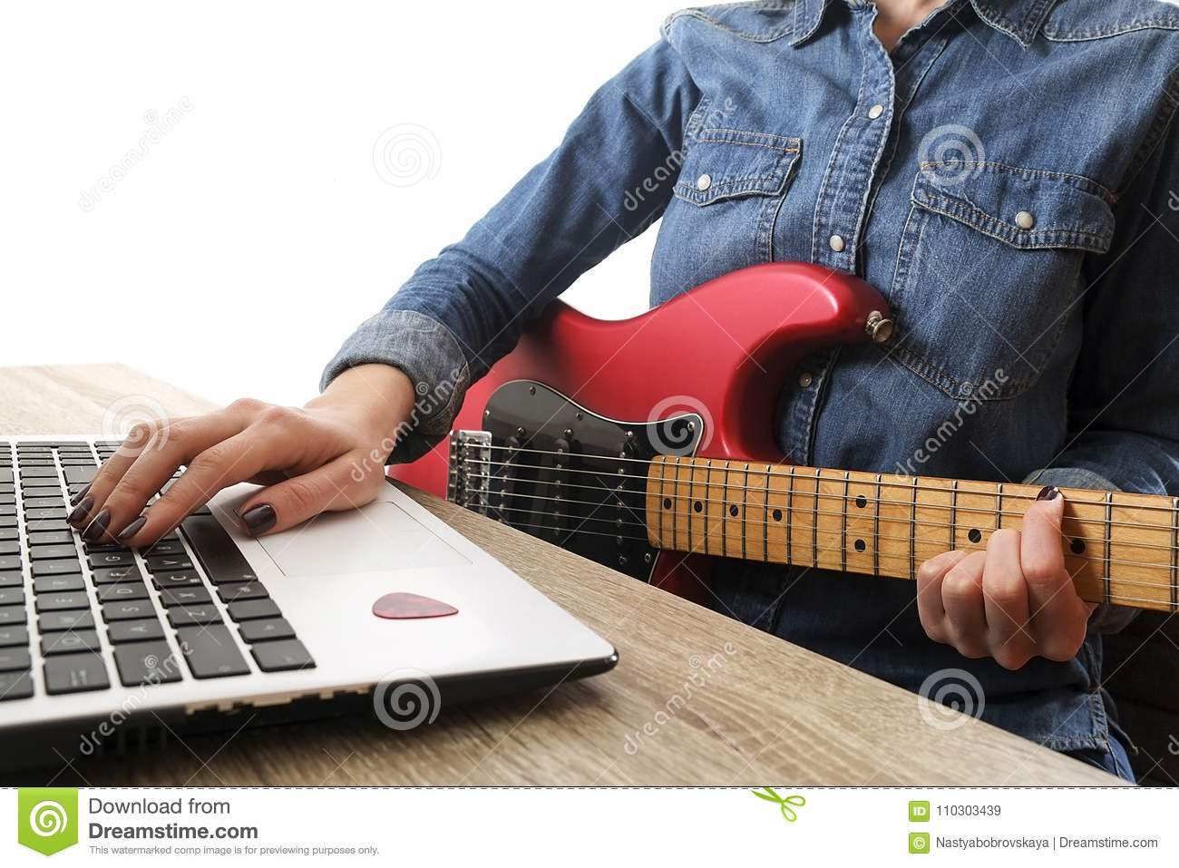 Casually Dressed Young Woman With Guitar Playing Songs In