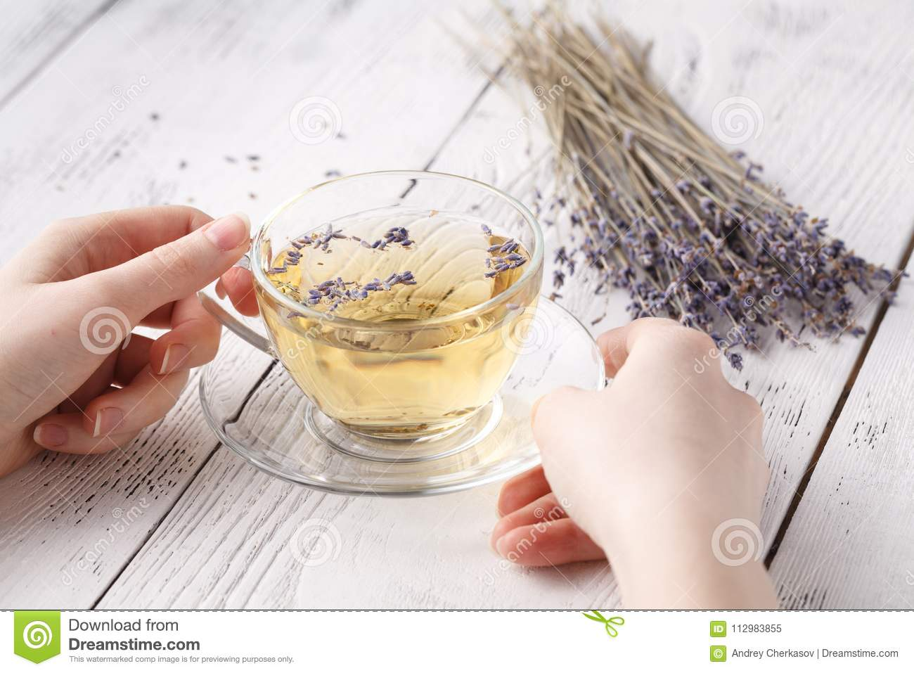 Female hold hot aromatic herbal tea