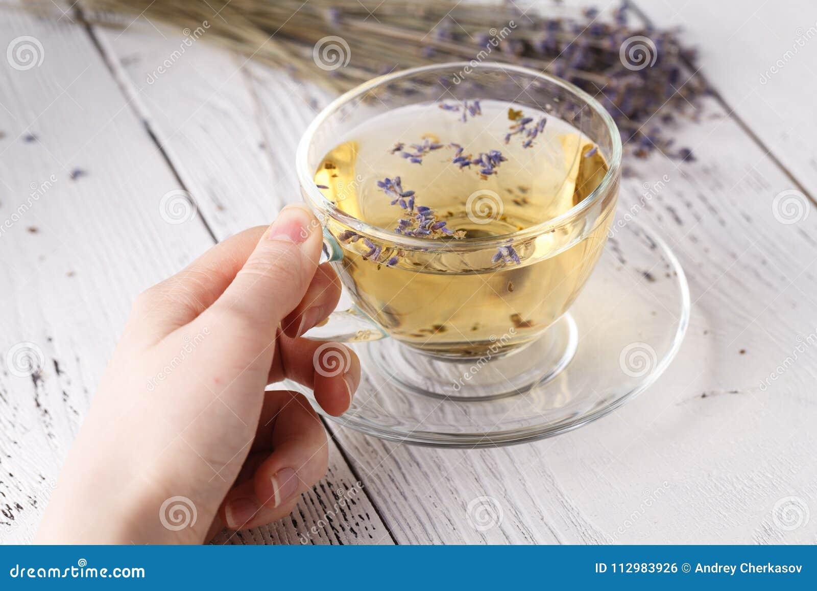 Female hold hot aromatic herbal tea