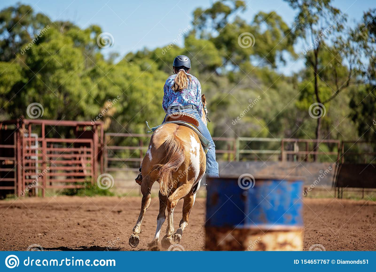 Cowgirl Competing In Barrel Racing At Outback Country Rodeo