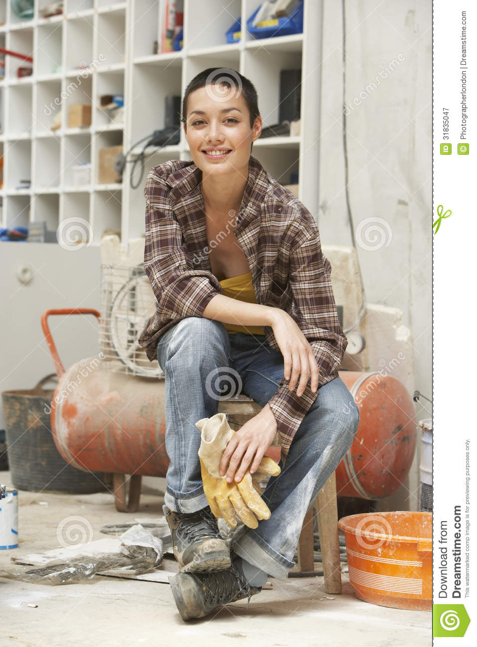 Female interior decorator sitting on stool in work site for Innendekorateur video
