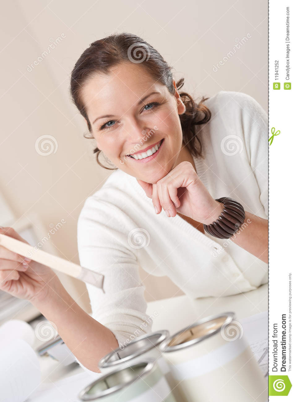 Female Interior Designer With Cans Of Paint Stock Photo