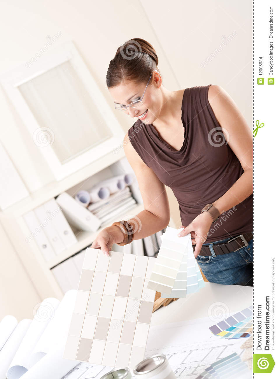 Female Interior Designer Choosing Color Of Tiles Stock
