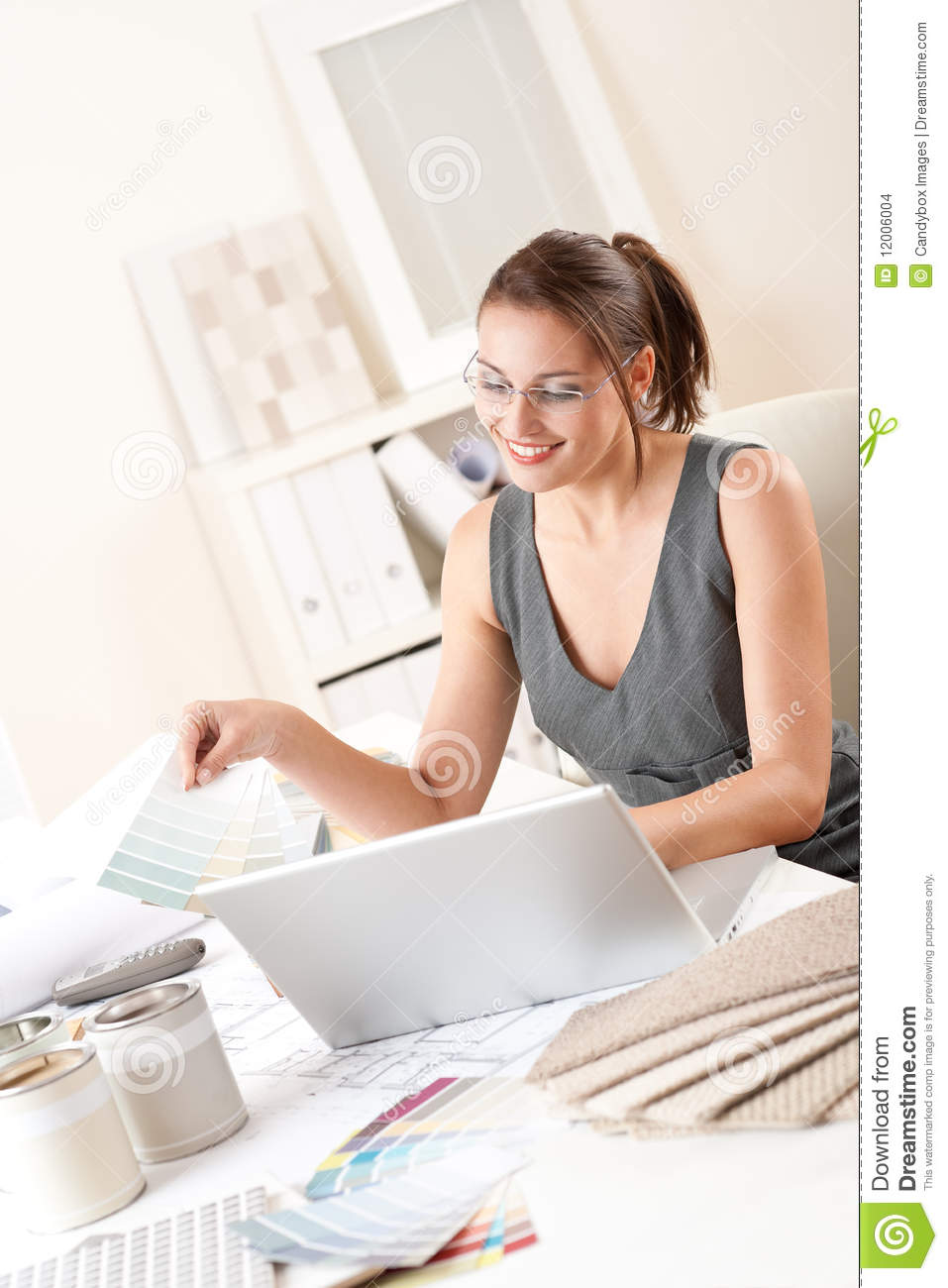Female Interior Designer Holding Color Swatches Stock