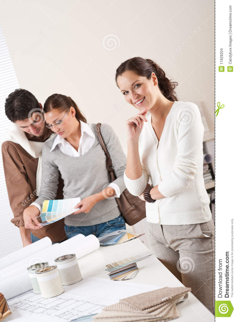 Female interior designer with two clients stock images for An interior designer