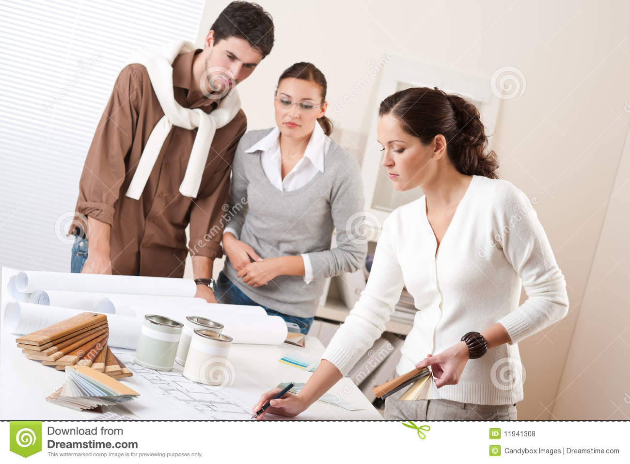 Female interior designer with two clients stock photo for How to find interior design clients