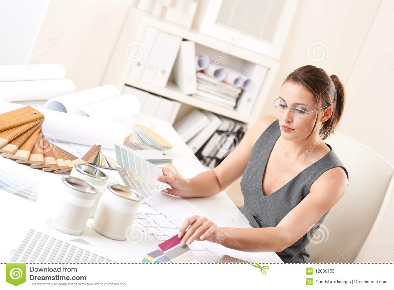 Female Interior Designer Working With Color Swatch Stock
