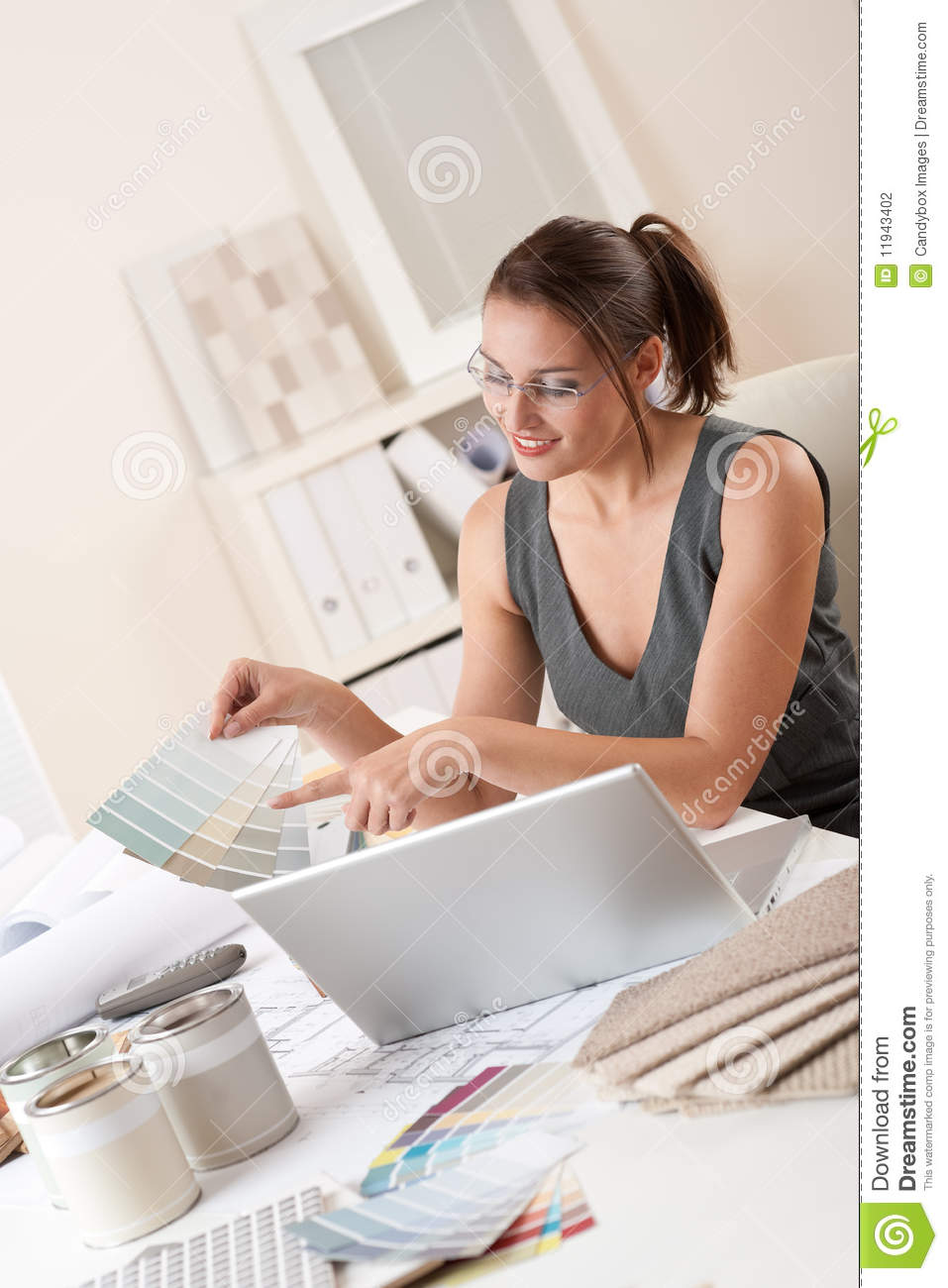 Female Interior Designer Working At Office Stock