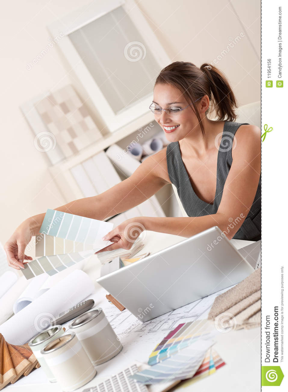 Female Interior Designer Working At Office Royalty Free