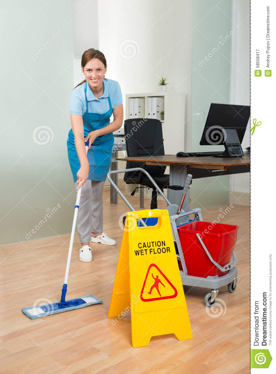 Happy Female Janitor With Cleaning Equipments Cleaning Hardwood Floor ...