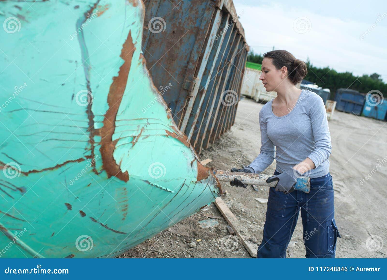 Female junk yard worker