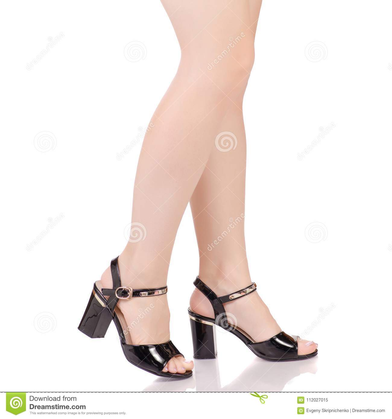 f8f2cb2a7 Female legs in black lacquered shoes sandals beauty fashion buy shop on white  background isolation
