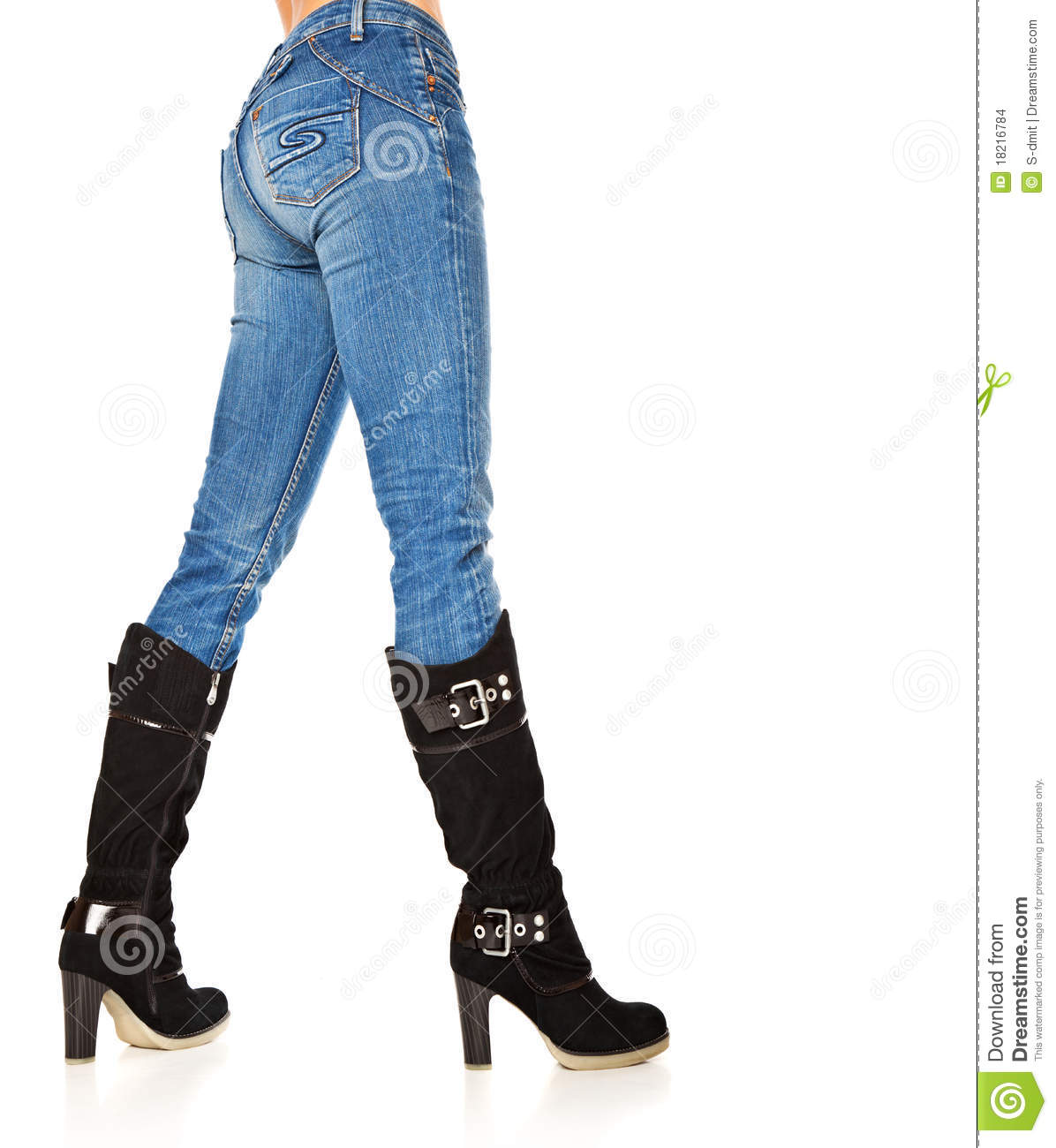 Female legs in a blue jeans and high boots