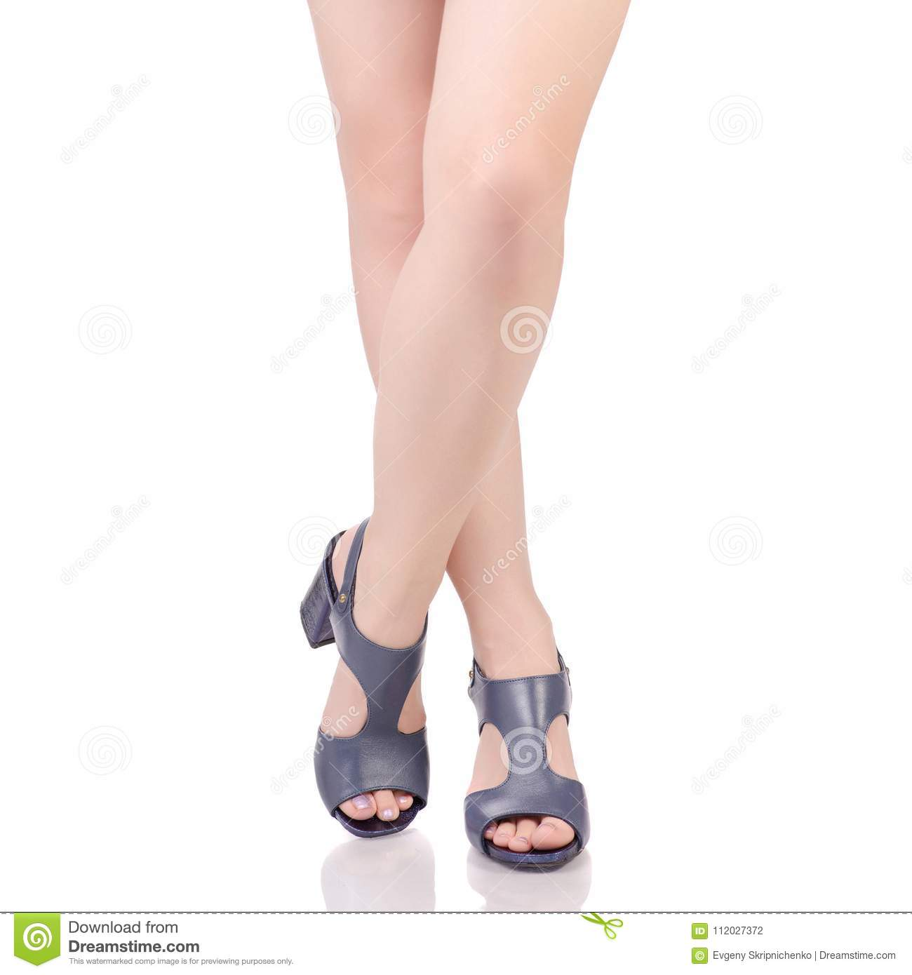 002b031e6 Female legs in blue leather shoes sandals beauty fashion buy shop on white  background isolation