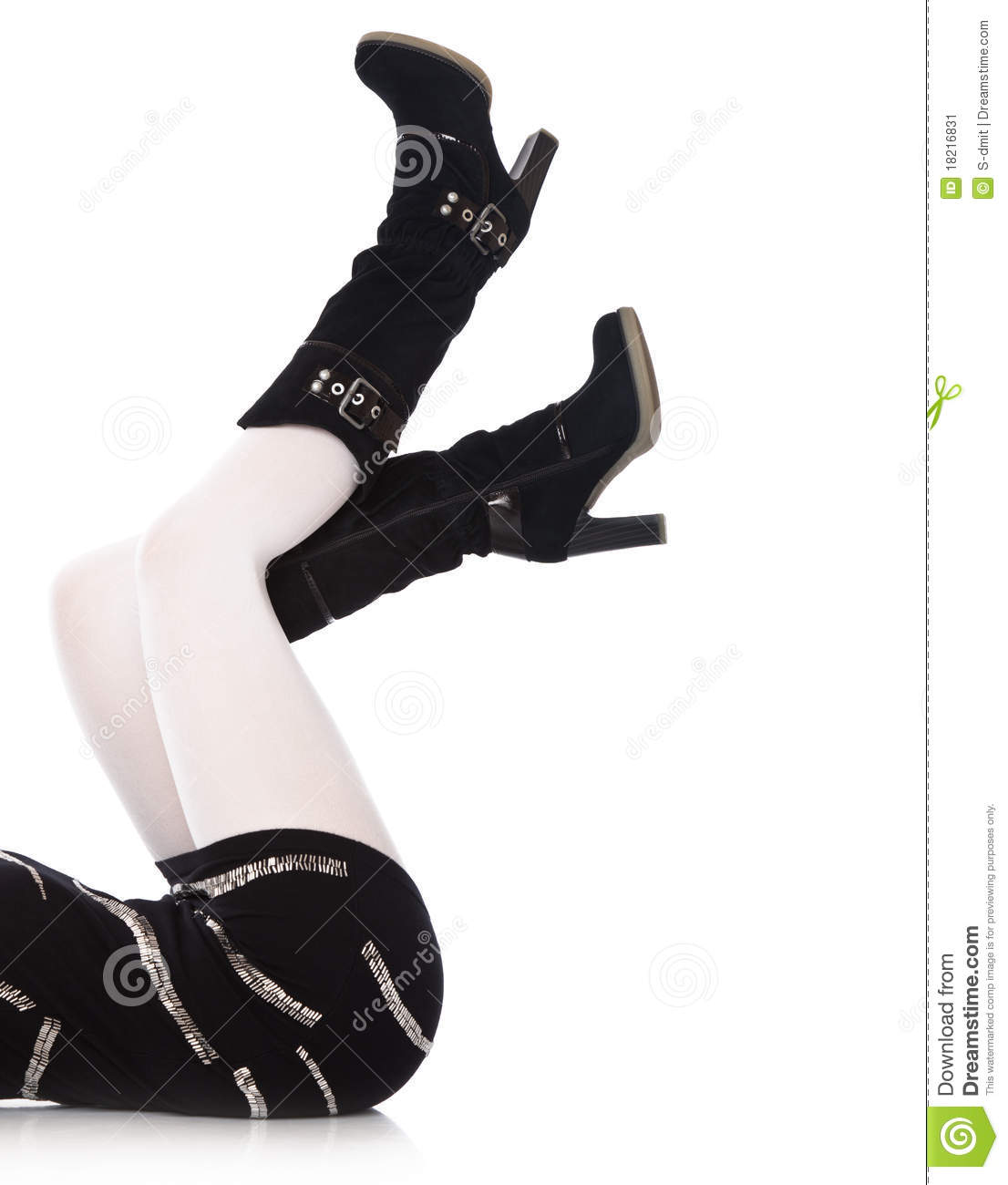 Female legs in high boots close-up