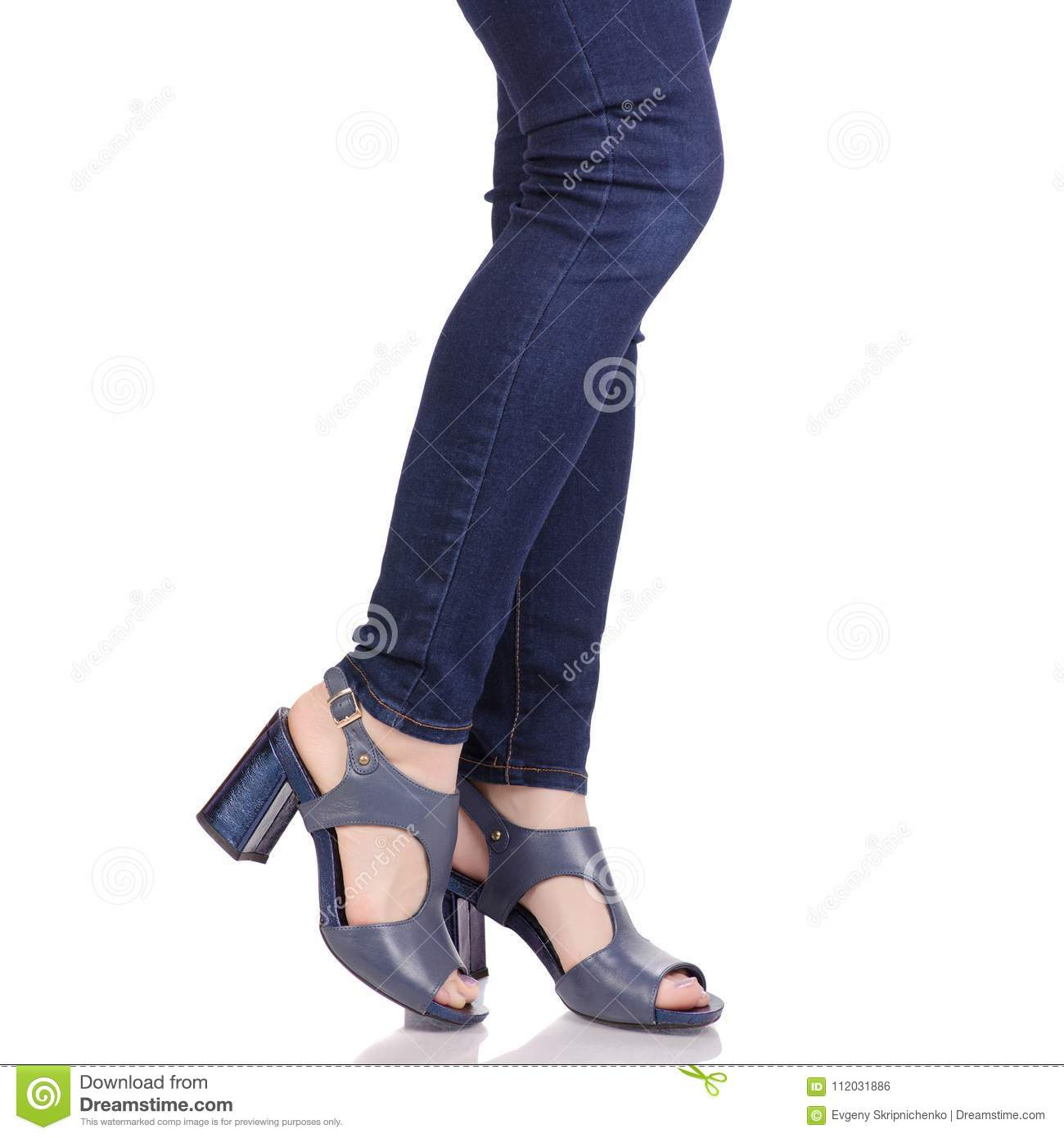 2ea743f3c Female legs in jeans and in blue sandals shoes fashion beauty shop buy on  white background isolation