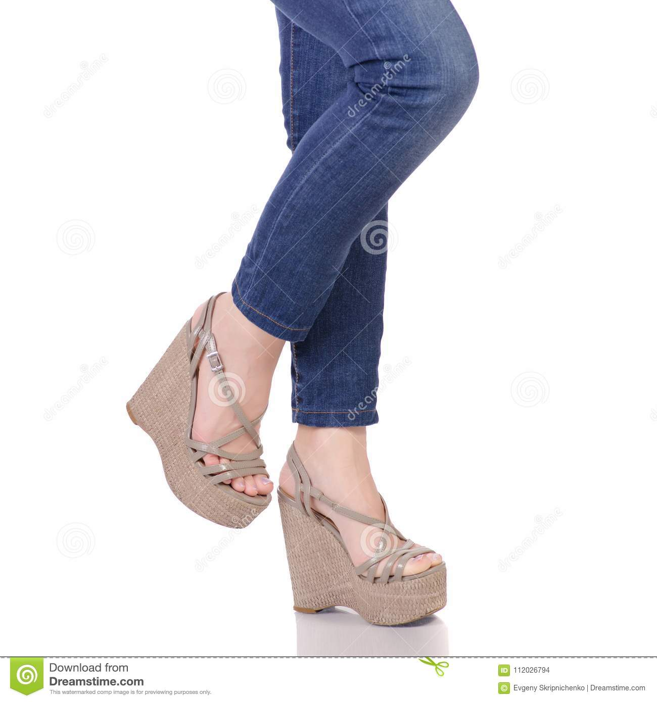 473dacafc Female legs in jeans and gray sandals on a wedge buy shop fashion beauty on  a white background isolation