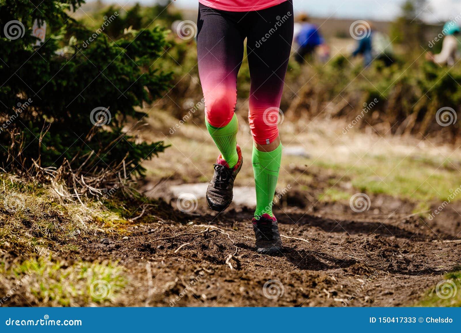 Female Legs Runner In Compression Socks