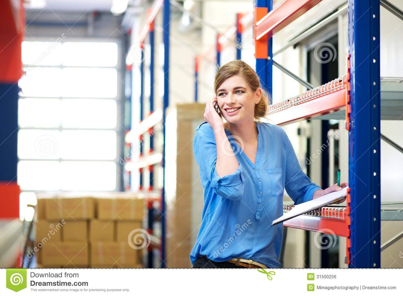 Female Logistics Worker Controlling Stock And Talking On