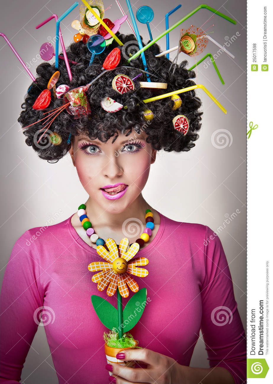 Female with lollipops in the hair