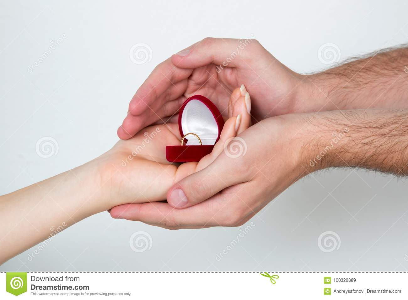 Female And Male Hands Holding The Ring Box Stock Image - Image of ...