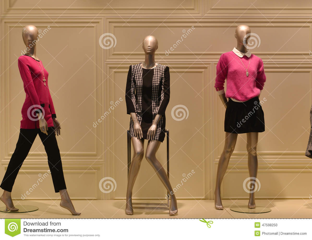 Female Mannequins In A Fashion Clothing Shop Window Stock
